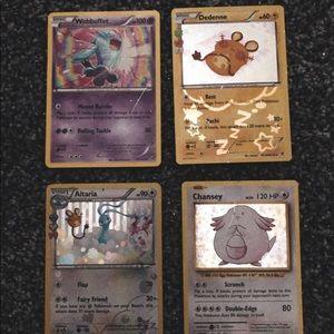 •set of four pokémon cards• BONUS:POCKET FOR CARDS